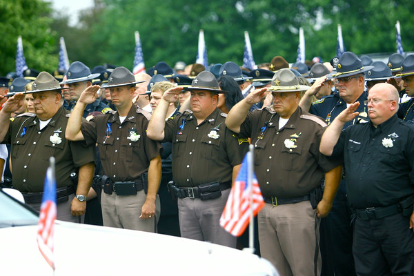 7-7-14   --- Funeral for Tipton County Deputy Jacob Calvin held at Carroll High School with burial at Maple Lawn Cemetery. --<br />   Tim Bath | Kokomo Tribune