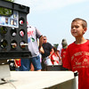 7-26-14<br /> Kids Fishing Clinic<br /> Kaiden Petty, 7, watches as his fish get weighed during tournament day of the Kids Fishing Clinic.<br /> Kelly Lafferty | Kokomo Tribune