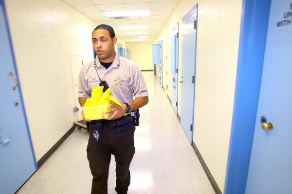 7-9-14 <br /> Sgt Justin Christmas delivering meds at the Howard County Criminal Justic Center.<br /> Tim Bath | Kokomo Tribune