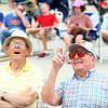 7-26-14<br /> Kokomo Air Show<br /> Bill Farrer and Darrell Howell look toward the skies as a plane performs tricks during the Kokomo Air Show.<br /> Kelly Lafferty | Kokomo Tribune
