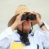 7-26-14<br /> Kokomo Air Show<br /> Christopher Gray watches the Kokomo Air Show with his binoculars on Saturday afternoon.<br /> Kelly Lafferty | Kokomo Tribune
