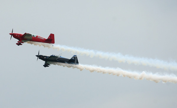 7-26-14<br /> Kokomo Air Show<br /> Firebirds Team performs for the crowd gathered at Kokomo's Airport for the Kokomo Air Show on Saturday afternoon.<br /> Kelly Lafferty | Kokomo Tribune