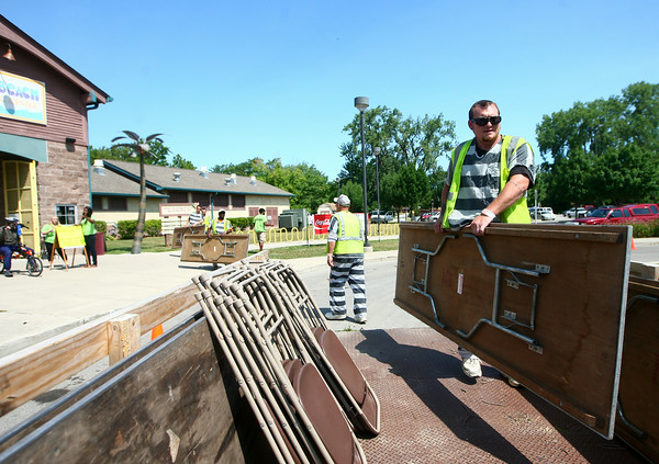 7-17-14<br /> Dustin Prater loads tables onto a trailer at Kokomo Beach with the rest of an inmate work crew on Thursday morning to help set up for the Duck Derby that night.<br /> Kelly Lafferty | Kokomo Tribune