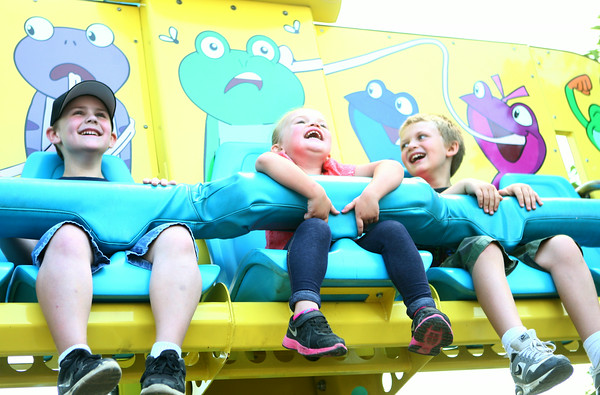 7-9-14<br /> Fair--Wednesday<br /> Kinser Welcher, Tanessa Obenchain, and Teagan Obenchain laugh on one of the kid's rides at the Howard County 4H Fair.<br /> Kelly Lafferty | Kokomo Tribune
