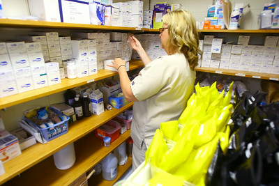 7-9-14  Nurse Andrea Stonestreet prepares meds for one of the inmates that has mental health problems at the Howard County Criminal Justic Center. Tim Bath | Kokomo Tribune