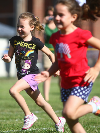 7-5-14<br /> Haynes Apperson Sports<br /> 5-year-old Charlotte Dascoli runs during the Haynes Apperson Kids Track Meet on Saturday morning.<br /> Kelly Lafferty | Kokomo Tribune