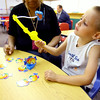 7-9-14 <br /> Zander Snow plays a letter, number and color game with teacher Darlene Graves on letters using pictures during Early Head Start at Darrough Chapel.<br /> Tim Bath | Kokomo Tribune