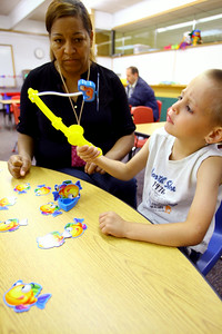 7-9-14  Zander Snow plays a letter, number and color game with teacher Darlene Graves on letters using pictures during Early Head Start at Darrough Chapel. Tim Bath | Kokomo Tribune