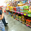6-30-14   --- Teresa Hudson helps customer Caleb Koors at Mr. Fireworks at US31 and Gano.  --<br />   Tim Bath   Kokomo Tribune