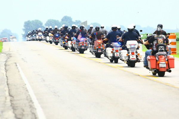 7-7-14   --- Funeral for Tipton County Deputy Jacob Calvin held at Carroll High School with burial at Maple Lawn Cemetery. --<br />   Tim Bath   Kokomo Tribune