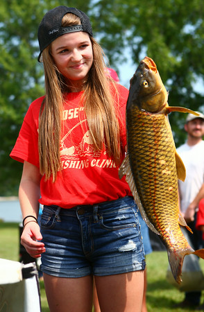7-26-14<br /> Kids Fishing Clinic<br /> 13-year-old Sophie Norfleet holds up her big fish after weigh-in at the Kids Fishing Clinic.<br /> Kelly Lafferty | Kokomo Tribune