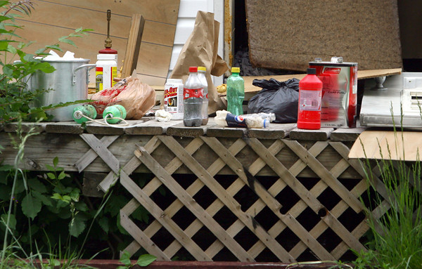 5-22-13<br /> City building inspector Charlie Hackett found a house at 1224 N. Union Street that was broken into. He found a meth lab or remnants of a meth lab in the burned out house.<br /> KT photo | Tim Bath