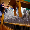 5-3-13<br /> Reynolds Associates Inc.,  replaces the pipes, cleans them and tunes them at Grace United Methodist Church at the end of the remodeling work. The organ keyboards also had to be put back in place after the remodel. David Reynolds tunes each pipe as Cory Kline hits each key.<br /> KT photo | Tim Bath