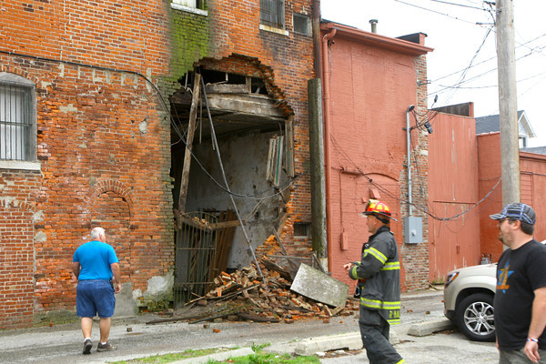 6-4-14   --- Kokomo firefighters secure the area behind the Turner Building sometimes more recently called the Barko building.  The owner wonders closer to the building but is quickly moved away by firefighters. --<br />   Tim Bath | Kokomo Tribune