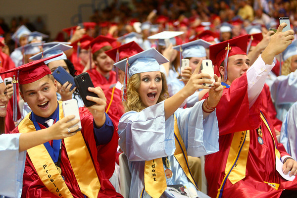 6-7-14<br /> Maconaquah Graduation<br /> Alyssa Shields (center) takes a selfie at the same time as everyone in Maconaquah's gym during the valedictorian's speech at the graduation ceremony.<br /> Kelly Lafferty | Kokomo Tribune