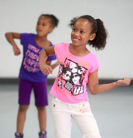 6-12-14<br /> Carver Community Center Hip Hop Class<br /> Tekira Ferguson, 8, smiles as Carver Community Center's Hip Hop Class practices a dance number.<br /> Kelly Lafferty | Kokomo Tribune