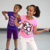 6-12-14<br /> Carver Community Center Hip Hop Class<br /> Tekira Ferguson, 8, smiles as Carver Community Center's Hip Hop Class practices a dance number.<br /> Kelly Lafferty | Kokomo Tribune