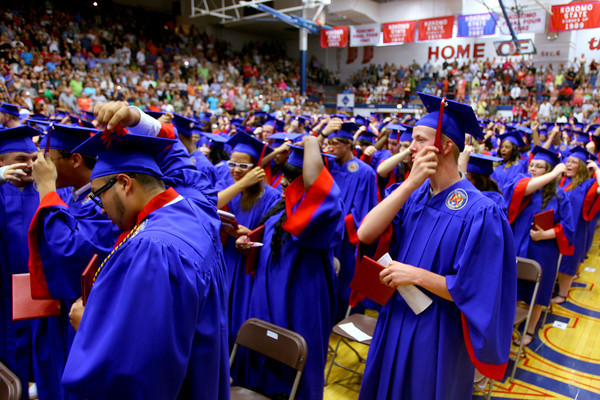 6-6-14   --- Allen Davis(right) moves his tassle at KHS Graduation. --<br />   Tim Bath | Kokomo Tribune