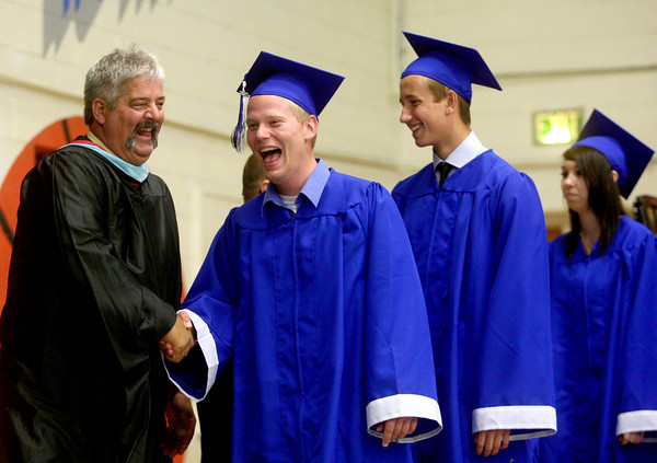 5-31-14<br /> Tipton graduation<br /> Tyler Spitz shares a laugh with Tipton's principal, Joe Rushton, before Spitz walks across the stage for his diploma.<br /> Kelly Lafferty | Kokomo Tribune