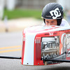 6-21-14<br /> Soap box Derby<br /> Monica Conwell peeks over her soap box derby car as she races toward the finish line on Main Street.<br /> Kelly Lafferty | Kokomo Tribune