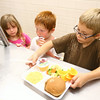 6-24-14<br /> Taylor Primary Lunch<br /> Connor Hole, 6, gets his tray of food during lunch at Taylor Primary School.<br /> Kelly Lafferty | Kokomo Tribune