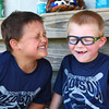 6-3-14<br /> Greentown<br /> Hochstedler Red Sox players Jordan Roberts (left) and Kyan Hannah have some fun in the dugout during their rookie league game in Greentown.<br /> Kelly Lafferty | Kokomo Tribune