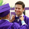 6-7-14<br /> Northwestern Graduation<br /> Alex Williams gets his bow tie straightened before the start of the procession of Northwestern's graduation ceremony.<br /> Kelly Lafferty | Kokomo Tribune