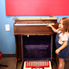 6-20-14<br /> American Dream HiFi<br /> 2-year-old Naomi Black plays on the electric organ at American Dream HiFi.<br /> Kelly Lafferty | Kokomo Tribune