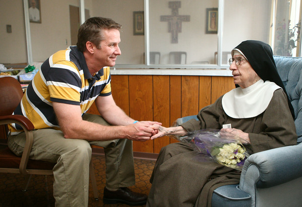 6-27-14 <br /> 100-year-old nun <br /> Dr. Chuck Dietzen visits with Sister Bernadette at the Poor Clares Monastery. Dietzen, who has known Sister Bernadette for all 53 years of his life, brought her flowers and a gift for her 100th birthday. <br /> Kelly Lafferty | Kokomo Tribune