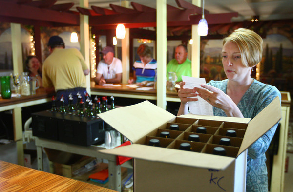 "6-6-14<br /> Oak Hill Winery's Tasting room ""31""<br /> Chris Beisiegel packs a box full of wine for a customer at Oak Hill Winery's new tasting room called ""31.""<br /> Kelly Lafferty 