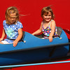 6-25-14<br /> Miami County Fair<br /> Best friends 4-year-old Andrea Hoover and 3-year-old Marlina Morgan are windblown as they enjoy their time on one of the rides at the Miami County Fair.<br /> Kelly Lafferty | Kokomo Tribune