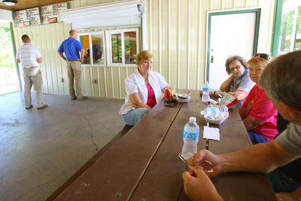 6-6-14   --- New food setup at the concession stands at Highland Park and Kokomo Beach consisting of Mexican food on top of the normal fair. Pat Swarey, Joan DeFord, Cathy Grass, Wendy Zeider(hidden) and Gary Dunwoody sit around a table talking after eating. --<br />   Tim Bath | Kokomo Tribune