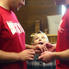 6-27-14 <br /> Same sex weddings<br /> Cayden Day, son of Joshua Day (left) looks up as he watches Joshua Day and Brandon Patrick exchange rings during their marriage ceremony at the Howard County Courthouse on Friday.<br /> Kelly Lafferty | Kokomo Tribune