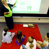 6-17-14   --- iRead summer reading program to help those kids with that are struggling with reading. Teacher Marcy Brown working with a group of kids while playing a teaching game. --<br />   Tim Bath | Kokomo Tribune