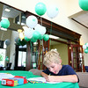 6-24-14<br /> First Farmers Bank & Trust open house<br /> Landon Sweatt colors in a children's area during First Farmers Bank & Trust's open house for their grand opening.<br /> Kelly Lafferty | Kokomo Tribune