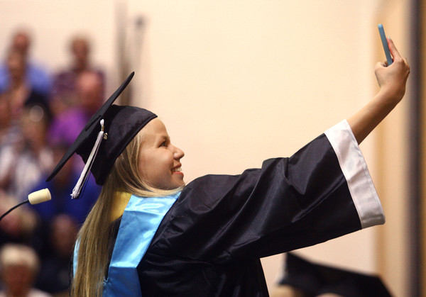 6-6-14<br /> Western Graduation<br /> Western salutatorian Summer Brown takes a selfie from the stage before she gives her speech at the graduation ceremony.<br /> Kelly Lafferty | Kokomo Tribune