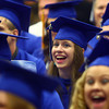 5-31-14<br /> Tipton graduation<br /> Rebekah Hunt laughs during a song performed by Tipton's principal, Joe Rushton, at the graduation ceremony.<br /> Kelly Lafferty | Kokomo Tribune