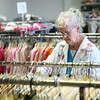6-27-14<br /> Salvation Army Thrift Store<br /> Joan Bryan looks through clothes at the new location of the Salvation Army Thrift Store.<br /> Kelly Lafferty | Kokomo Tribune