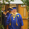 5-31-14<br /> Tri Central graduation<br /> Kaleb Unger walks through the archway in Tri Central's gym at the start of the graduation ceremony.<br /> Kelly Lafferty | Kokomo Tribune