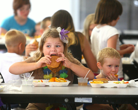 6-24-14<br /> Taylor Primary Lunch<br /> Skye Pratt, 8, and Braxton Davis, 4, eat their lunch in Taylor Primary's cafeteria.<br /> Kelly Lafferty | Kokomo Tribune