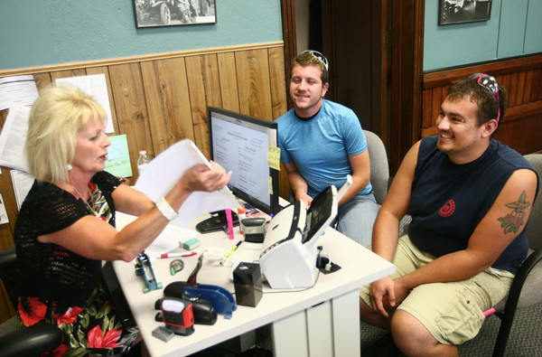 6-25-14<br /> First Howard County same sex marriage<br /> Brandon Patrick and Joshua Day go over marriage paperwork with Deputy clerk Mona Sadler at the Howard County Courthouse on Wednesday. Patrick and Day are the first same-sex couple to get married in Howard County.<br /> Kelly Lafferty | Kokomo Tribune