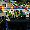 6-5-14   --- E & B Paving workers Dave Steelman, Jason Henderson and Darryl Wood work on putting in pavers along along the trail on Buckeye Street downtown between Taylor and Mulberry Streets.    --<br />   Tim Bath | Kokomo Tribune