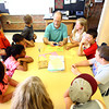 5-29-14<br /> Paul Buesking's art class at Bon Air<br /> Art teacher Paul Buesking demonstrates how to make a symmetrical pot with cutting construction paper during a second grade art class at Bon Air.<br /> Kelly Lafferty | Kokomo Tribune