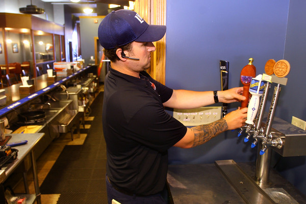6-2-14   --- New downtown bar called the district opening June 5. Owner is Todd Rudicel. Andy Betts from Monarch Beverage installs the taps for the craft beers that will be available. --<br />   Tim Bath | Kokomo Tribune