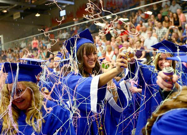 5-31-14<br /> Tipton graduation<br /> Anna Criser sprays silly string at her fellow high school graduates after Tipton's graduation ceremony.<br /> Kelly Lafferty | Kokomo Tribune