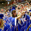 5-31-14<br /> Tipton graduation<br /> Anna Criser sprays silly string at her fellow high school graduates after Tipton's graduation ceremony.<br /> Kelly Lafferty | Kokomo Tribune