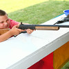 6-25-14<br /> Miami County Fair<br /> Evyn Manriquez, 10, aims the gun to shoot down a target at one of the games at the Miami County Fair.<br /> Kelly Lafferty | Kokomo Tribune