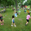 6-25-14<br /> Craft Fest<br /> Kids walk around the perimeter of the candle making station as they from candles with wax and water at the Craft Fest in Highland Park.<br /> Kelly Lafferty   Kokomo Tribune