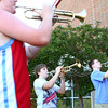 6-3-14<br /> Greentown<br /> Christian Ford and Gavin Bailey practice playing their trumpets for the marching band outside of Eastern High School in Greentown.<br /> Kelly Lafferty | Kokomo Tribune