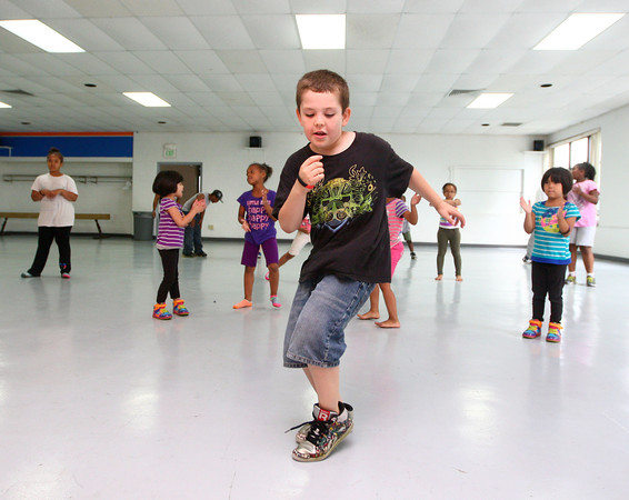 6-12-14<br /> Carver Community Center Hip Hop Class<br /> 9-year-old Tristan Santana dances a solo routine during one of the songs Carver Community Center's Hip Hop Class will be performing.<br /> Kelly Lafferty | Kokomo Tribune